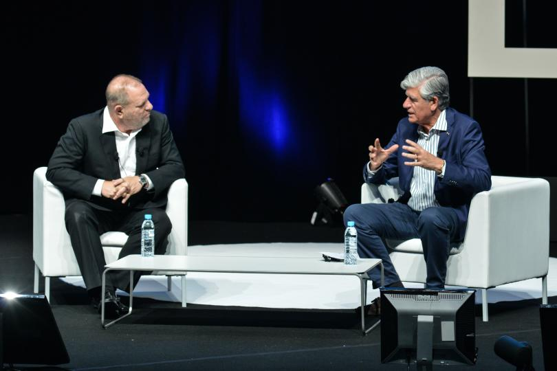 Maurice Levy, right, discusses McDonald's and creativity during his talk at Cannes with Harvey Weinstein.