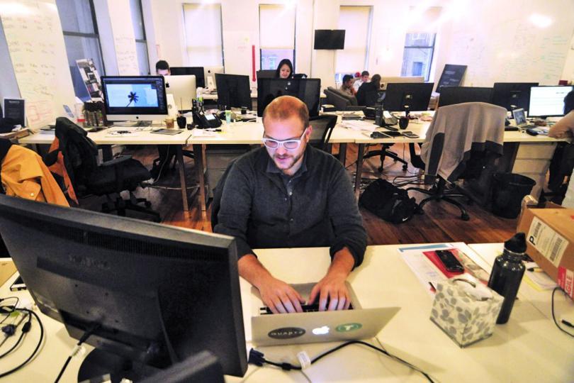 Quartz staffers at work in their New York office.
