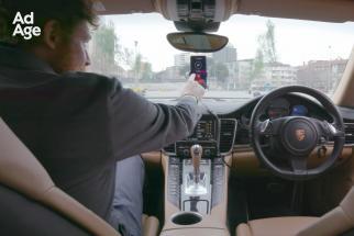 Watch a Mobile Phone With an AI Chip Pilot a Porsche